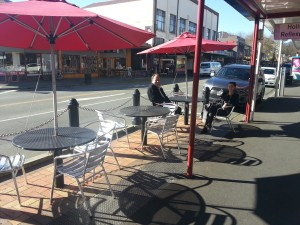 Paul Walden (Waiheke) and Danielle Grant (Kaipatiki) sit at one of Nelson's outside dining areas using former carparking space