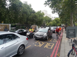 Commuter cycling along the Embankment, London