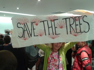 Save the trees banner  AT Board meeting